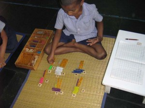 Hakim doing Multiplication with Coloured Bead Bars